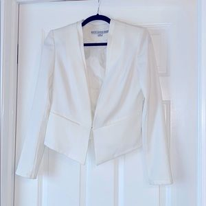 Short white suit jacket with padded shoulders